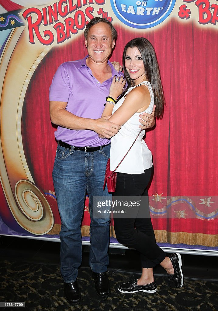 Reality TV Personality Heather Dubrow (R) and her husband Terry Dubrow (L) attend the premiere of Ringling Bros. And Barnum & Bailey's 'Built To Amaze!' at the Staples Center on July 11, 2013 in Los Angeles, California.