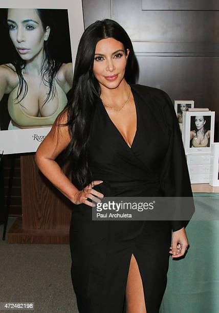 Reality TV Personality Kim Kardashian signs copies of her new book 'Selfish' at Barnes Noble bookstore at The Grove on May 7 2015 in Los Angeles...