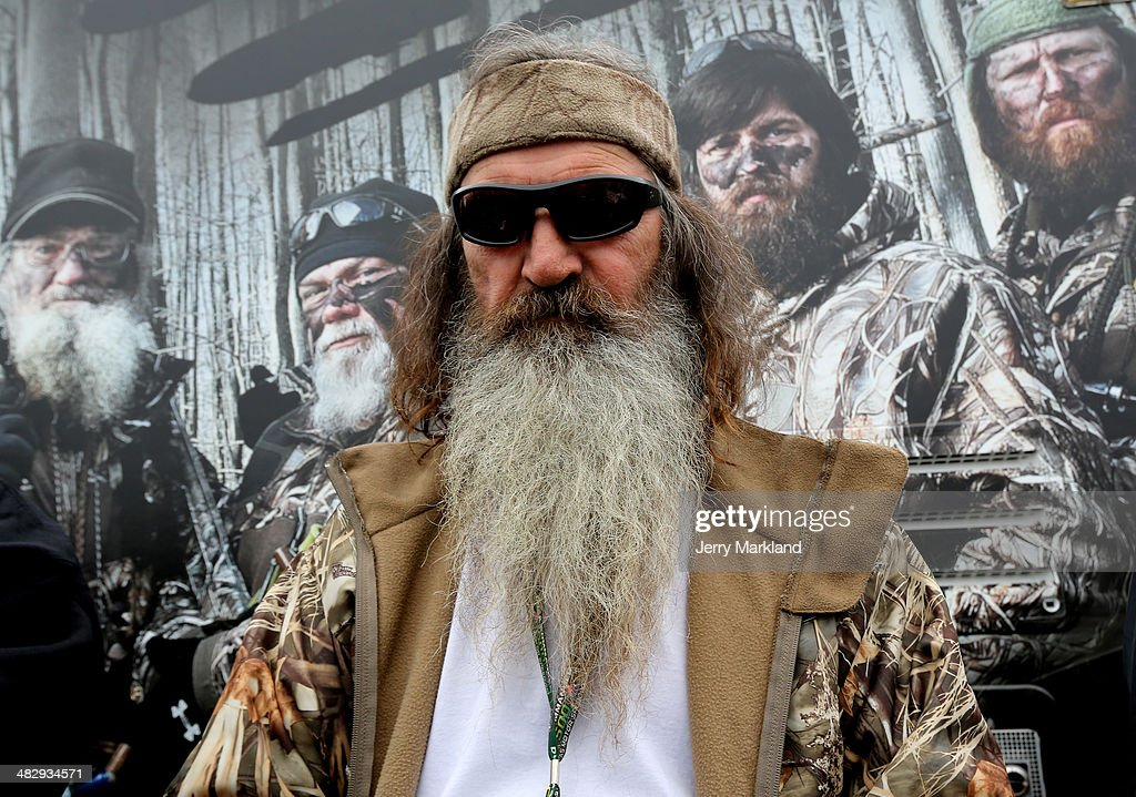 Reality TV personality <a gi-track='captionPersonalityLinkClicked' href=/galleries/search?phrase=Phil+Robertson&family=editorial&specificpeople=4043277 ng-click='$event.stopPropagation()'>Phil Robertson</a> greets fans in the Duck Commander Compound at Texas Motor Speedway on April 5, 2014 in Fort Worth, Texas.
