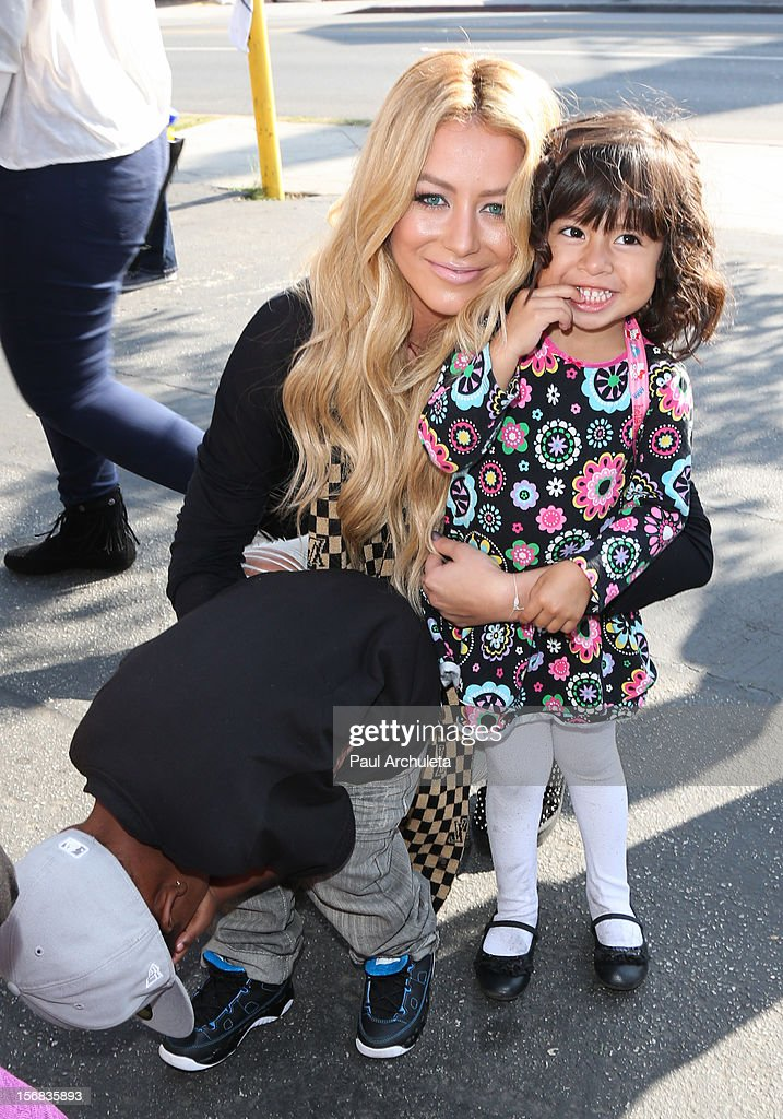 Reality TV Personality / Singer Aubrey O'Day (L) attends PATH's 4th Annual Thanksgiving Meal at Pink Taco on November 22, 2012 in Los Angeles, California.