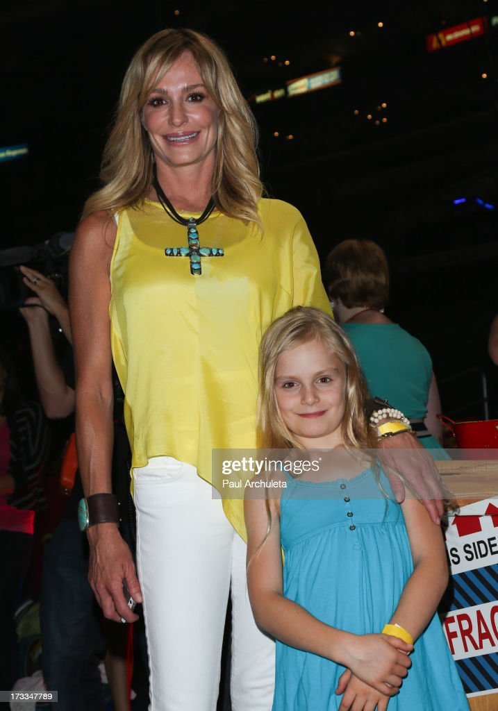 Reality TV Personality <a gi-track='captionPersonalityLinkClicked' href=/galleries/search?phrase=Taylor+Armstrong&family=editorial&specificpeople=6903739 ng-click='$event.stopPropagation()'>Taylor Armstrong</a> (L) attends the premiere of Ringling Bros. And Barnum & Bailey's 'Built To Amaze!' at the Staples Center on July 11, 2013 in Los Angeles, California.