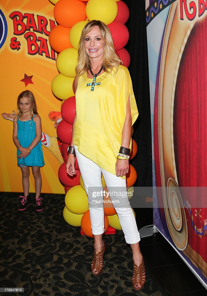 Reality TV Personality Taylor Armstrong (R) attends the premiere of Ringling Bros. And Barnum & Bailey's 'Built To Amaze!' at the Staples Center on July 11, 2013 in Los Angeles, California.