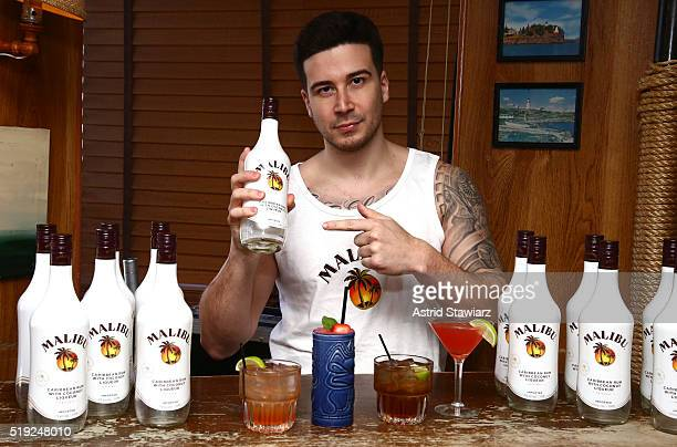 Reality TV star and selfproclaimed 'Malibro' Vinny Guadagnino shook up Malibu signature cocktails at The Rusty Knot on April 5 2016 in New York City