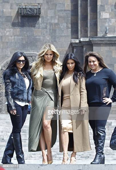 US reality TV star Kim Kardashian and her sister Khloe pose for pictures at a park in Yerevan on April 9 2015 AFP PHOTO / STRINGER