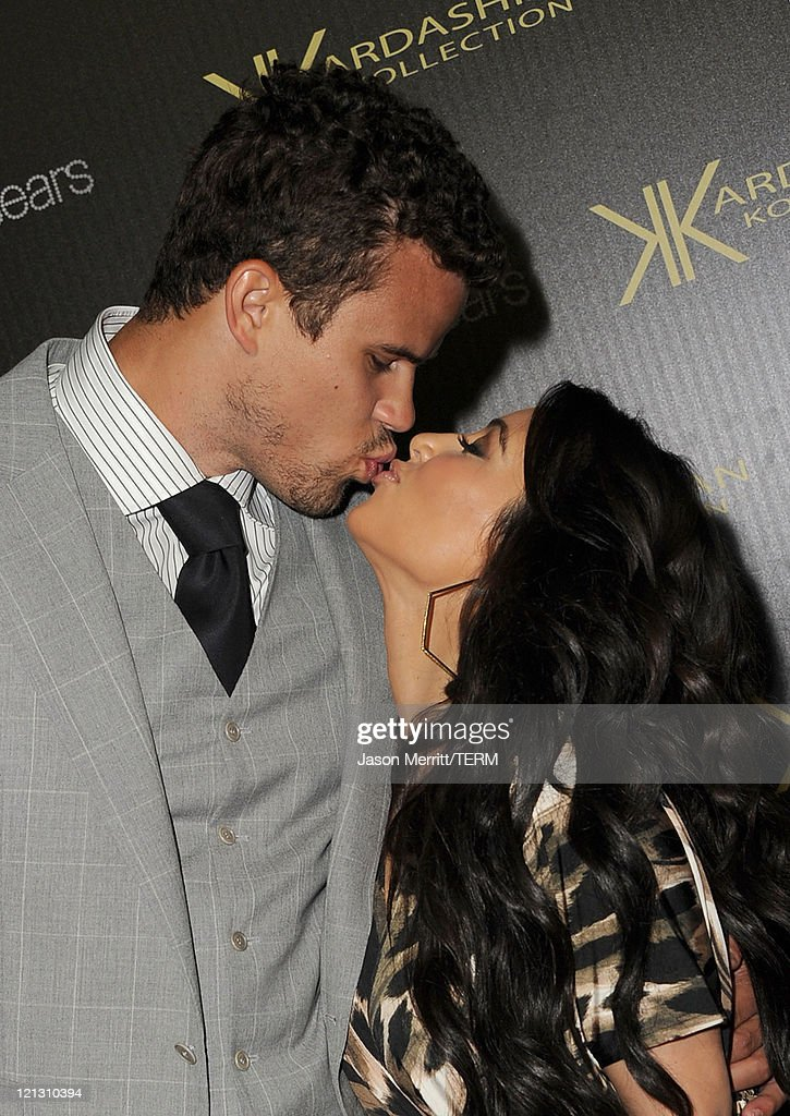 Reality TV star Kim Kardashian and New Jersey Nets forward basketball player Kris Humphries kiss on the red carpet of the Kardashian Kollection Launch Party on August 17, 2011 in Hollywood, California.