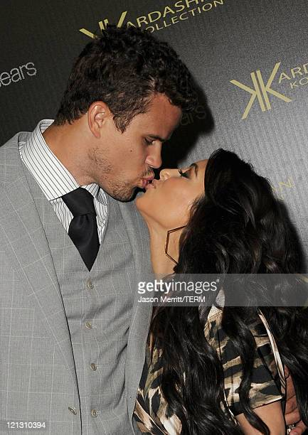 Reality TV star Kim Kardashian and New Jersey Nets forward basketball player Kris Humphries kiss on the red carpet of the Kardashian Kollection...