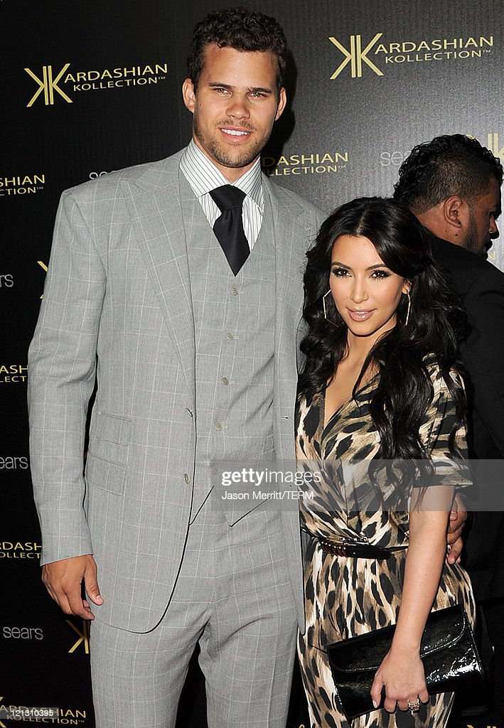 Reality TV star <a gi-track='captionPersonalityLinkClicked' href=/galleries/search?phrase=Kim+Kardashian&family=editorial&specificpeople=753387 ng-click='$event.stopPropagation()'>Kim Kardashian</a> and New Jersey Nets forward basketball player <a gi-track='captionPersonalityLinkClicked' href=/galleries/search?phrase=Kris+Humphries&family=editorial&specificpeople=209199 ng-click='$event.stopPropagation()'>Kris Humphries</a> arrive on the red carpet of the Kardashian Kollection Launch Party on August 17, 2011 in Hollywood, California.
