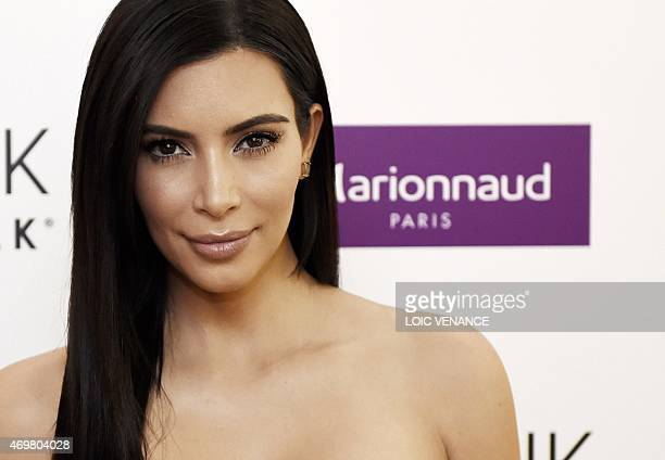 US reality TV star Kim Kardashian poses during a photocall to present her new cosmetic brand in Paris on April 15 2015 AFP PHOTO / LOIC VENANCE