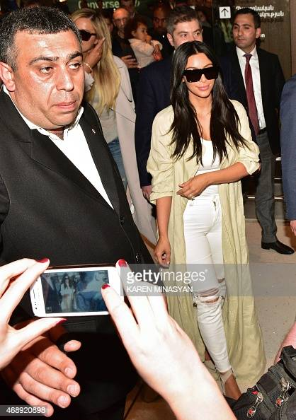 US reality TV star Kim Kardashian walks at the airport in Yerevan on April 8 2015 Kardashian and her family flew to Armenia on a first trip there to...