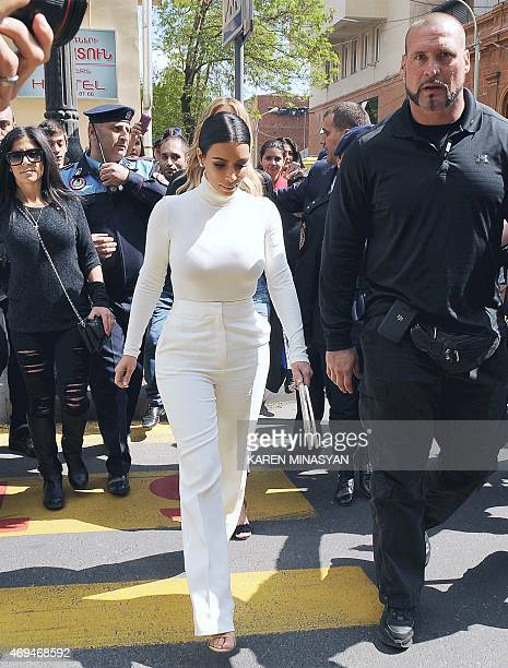 US reality TV star Kim Kardashian walks in the street followed by a crowd in Yerevan on April 12 during her first visit to Armenia to celebrate her...