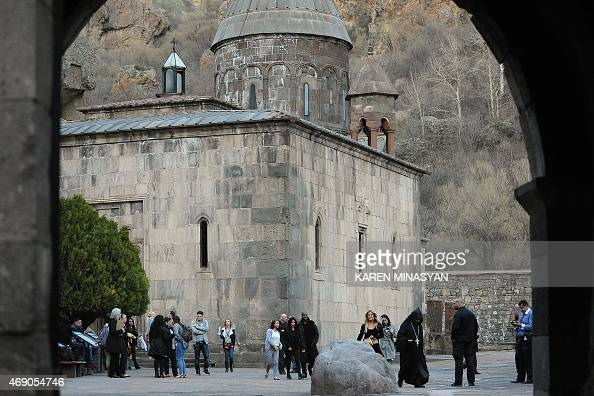 US reality TV star Kim Kardashian with her rapper husband Kanye West on April 9 2015 pose with local residents near the Geghard Monastery in Armenia...