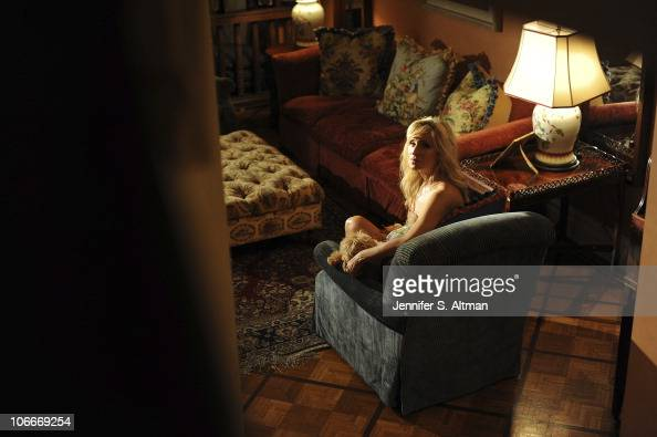 Reality tv star Sonja Morgan of the 'Real Housewives of New York' poses in her living room with her dog in New York on September 29 2010 Published...