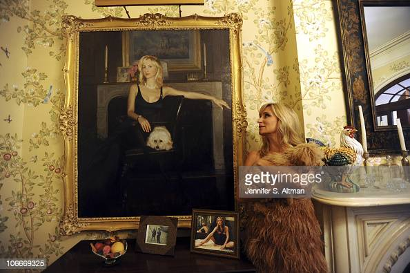 Reality tv star Sonja Morgan of the 'Real Housewives of New York' poses at her home with her dog in New York on September 29 2010 Published image