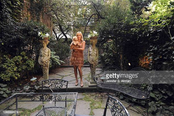Reality tv star Sonja Morgan of the 'Real Housewives of New York' poses in her garden with her dog in New York on September 29 2010 Published image