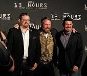 Reallife Benghazi security contractors John 'Tig' Tiegan Mark 'Oz' Geist and Kris 'Tanto' Paronto have fun on the red carpet with photographers...