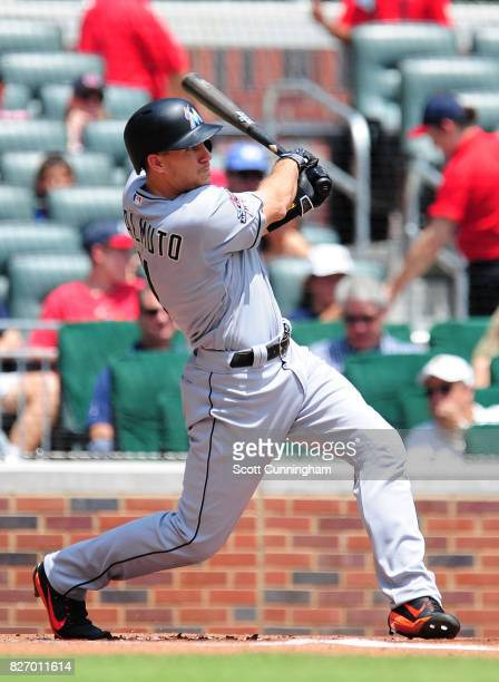 J T Realmuto of the Miami Marlins hits a first inning solo home run against the Atlanta Braves at SunTrust Park on August 6 2017 in Atlanta Georgia