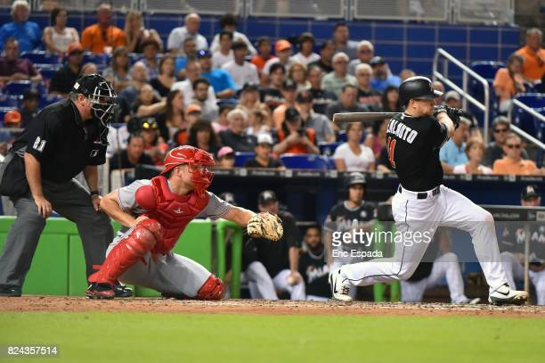 T Realmuto of the Miami Marlins hits an RBI single in the seventh inning against the Cincinnati Reds at Marlins Park on July 29 2017 in Miami Florida