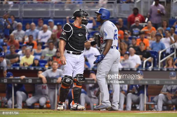 T Realmuto of the Miami Marlins holds back Yasiel Puig of the Los Angeles Dodgers after a close pitch in the first inning at Marlins Park on July 15...