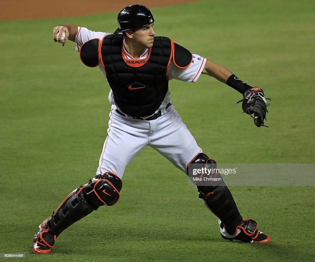 J.T. Realmuto #11 of the Miami Marlins makes a throw to first during a game against the Washington Nationals at Marlins Park on September 19, 2016 in Miami, Florida.