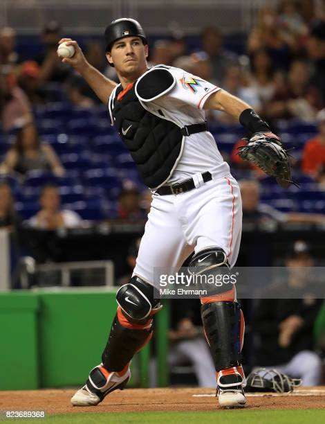 T Realmuto of the Miami Marlins makes a throw to first during a game against the Cincinnati Reds at Marlins Park on July 27 2017 in Miami Florida
