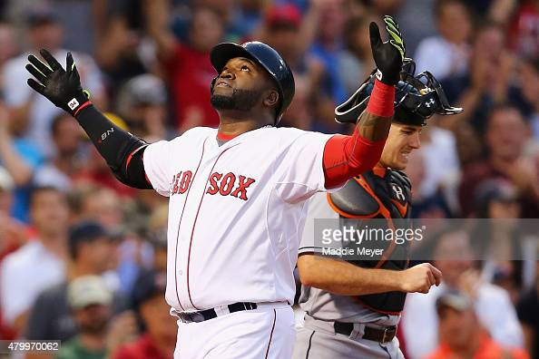 T Realmuto of the Miami Marlins reacts as David Ortiz of the Boston Red Sox celebrates his two run homer during the third inning at Fenway Park on...