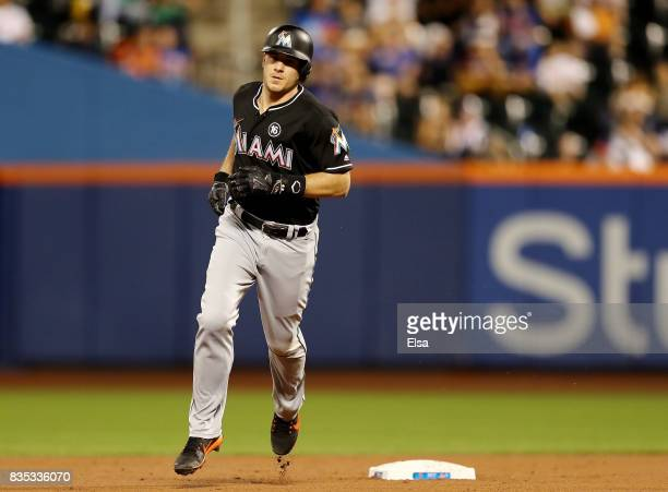 T Realmuto of the Miami Marlins rounds second base after he hit a two run home run in the second inning against the New York Mets on August 18 2017...