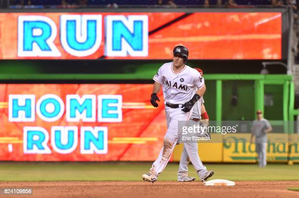T Realmuto of the Miami Marlins rounds second base after hitting a home run against the Cincinnati Reds at Marlins Park on July 28 2017 in Miami...
