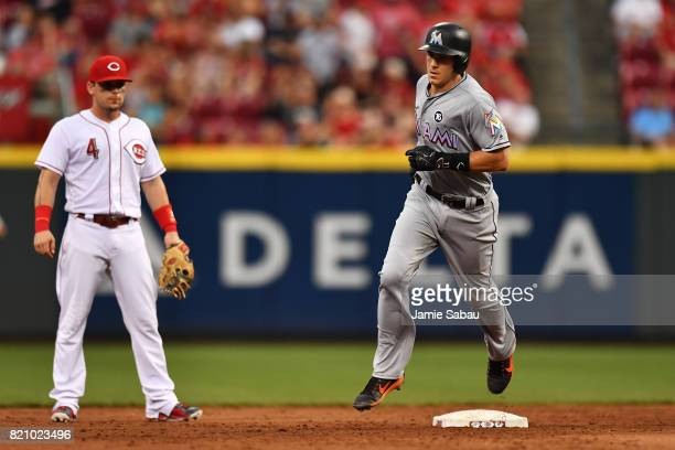 T Realmuto of the Miami Marlins rounds second base after hitting a tworun home run in the second inning against the Cincinnati Reds at Great American...
