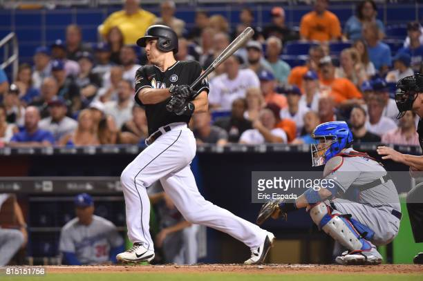 T Realmuto of the Miami Marlins singles in the second inning against the Los Angeles Dodgers at Marlins Park on July 15 2017 in Miami Florida