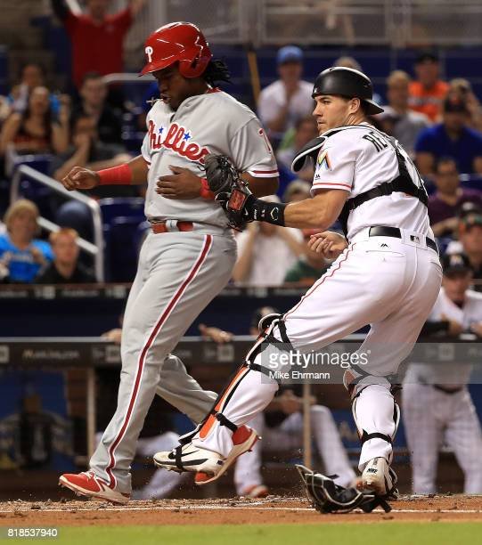 T Realmuto of the Miami Marlins tags out Maikel Franco of the Philadelphia Phillies during a game at Marlins Park on July 18 2017 in Miami Florida