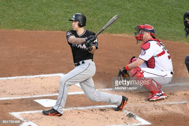 T Realmuto of the Miami Marlins takes a swing during a baseball game against the Washington Nationals at Nationals Park on August 9 2017 in...