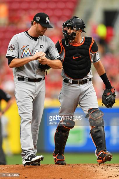 T Realmuto of the Miami Marlins talks with pitcher Chris O'Grady of the Miami Marlins in the first inning against the Cincinnati Reds at Great...