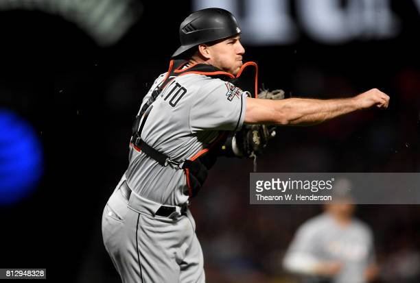 T Realmuto of the Miami Marlins throws to first base throwing out Hunter Pence of the San Francisco Giants in the bottom of the seventh inning at ATT...