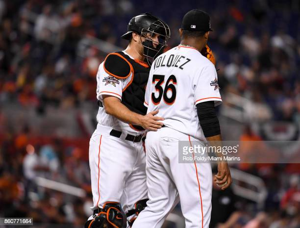 T Realmuto talks with Edinson Volquez of the Miami Marlins during the game against the New York Mets at Marlins Park on April 14 2017 in Miami Florida