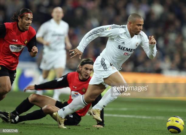 Real's Ronaldo gets past Mallorca's De Los Santos during the Primera Liga match between Real Madrid and Mallorca at the Bernabeu on January 23 2005...