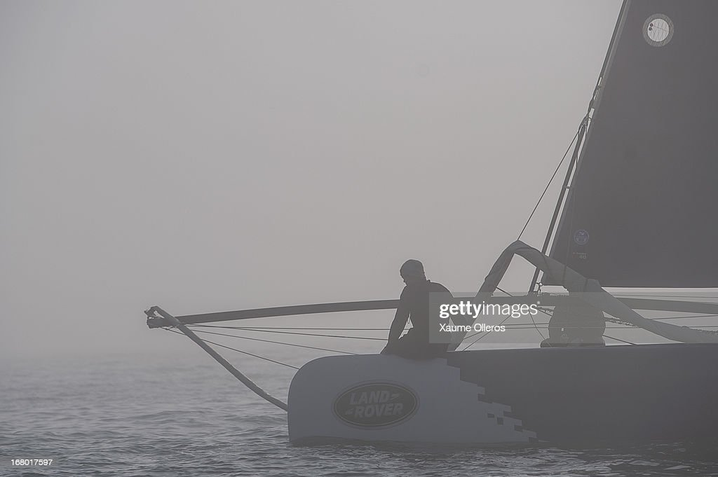 Realteam crew wait for the fog to desappear prior to day three of the Extreme Sailing Series on May 4, 2013 in Qingdao, China.