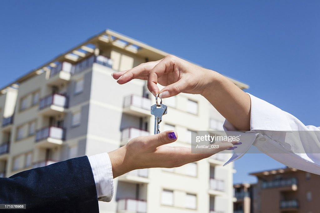 Realtor giving apartment keys