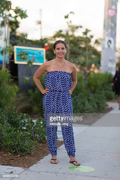 Realtor Kealoha Browning wears an Aqua by Bloomingdale's romper Tory Burch sandals a Kate Spade necklace and Angelica Smith Jewelry earrings on...