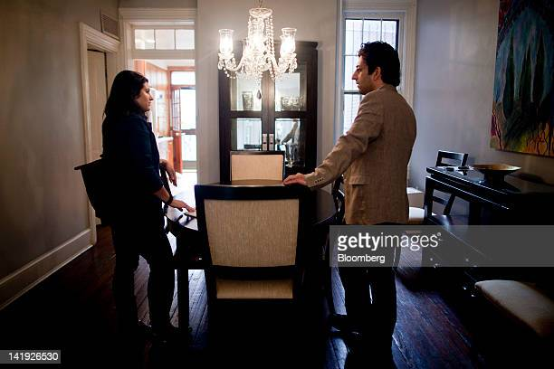 Realtor Sean Aalai right talks to potential homebuyer Jocyln Assarian inside a fivebedroom row house for sale in the Logan Circle neighborhood of...