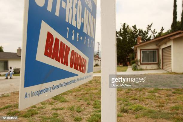 A realtor sign advertises a bankowned house for sale as a new California law that imposes a 90day moratorium on housing foreclosures takes effect...