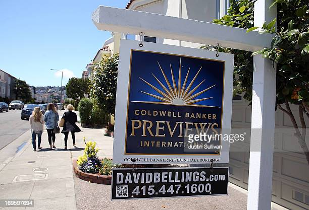 A realtor sign is posted in front of a home for sale on May 28 2013 in San Francisco California According to the Standard Poor's CaseShiller index US...