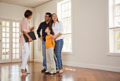 Realtor with family in empty room