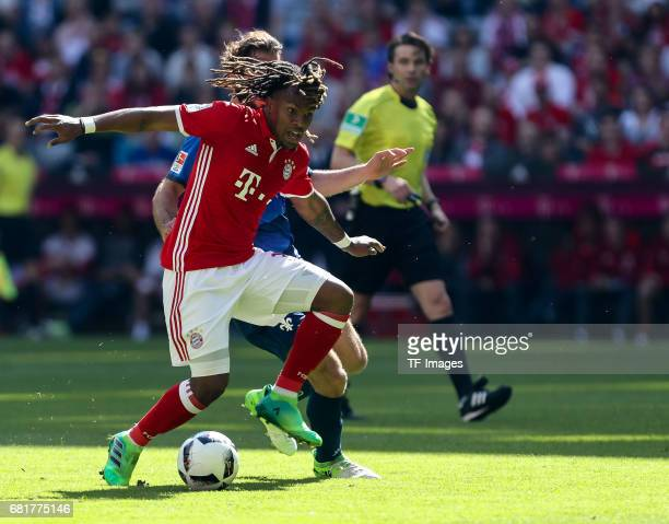 Reanato Sanches of Munich and Hamit Altintop of Darmstadt battle for the ball during the Bundesliga match between Bayern Muenchen and SV Darmstadt 98...