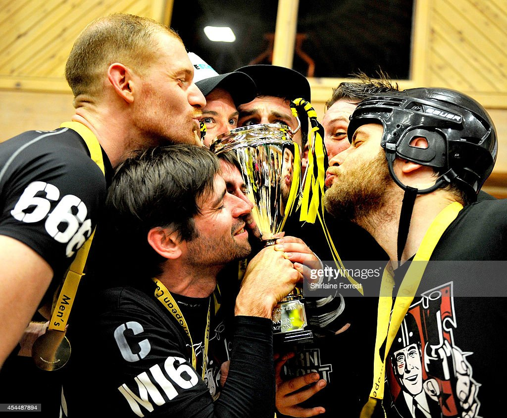 Reaper, Ballistic, Shrooms and Blitzkrieg of Southern Discomfort celebrate winning the Men's European Cup roller derby tournament at Walker Activity Dome on August 31, 2014 in Newcastle upon Tyne, England.