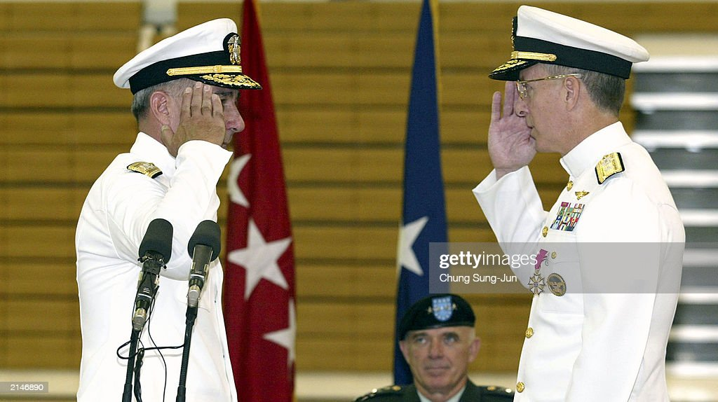 Rear Admiral Daniel S. Mastagni, new Commander of the U.S. Naval Forces in Korea, exchanges a salute with outgoing Rear Admiral Gary Jones during the Change of Command Ceremony at the Youngsan Army Base July 9, 2003 in Seoul, South Korea. Mastagni replaces Rear Admiral Gary Jones as Commander of the Forces in the region.
