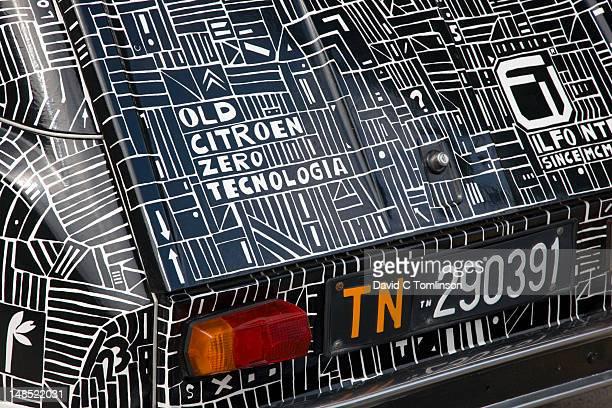 Rear detail of decorated car at Citroen 2CV rally.