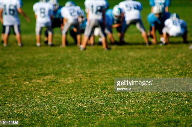 Rear distant view of American football players on the field