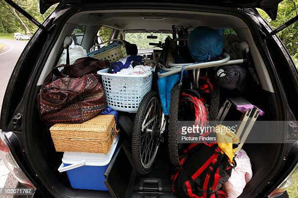 Rear of SUV vehicle packed with camping gear