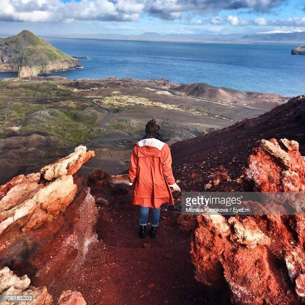 Rear View Full Length Of Woman At Vestmannaeyjar Looking At Sea
