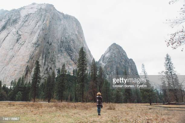 Rear View Full Length Of Woman Standing Against Mountains At Yosemite National Park